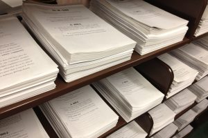 stacks of paper bills in Law Library of Congress Reading Room