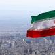 Iran national flag waving over Tehran skyline