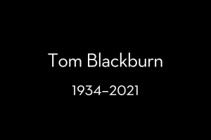 """Text on a black background that reads: """"Tom Blackburn, 1934–2021"""""""