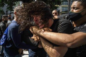 Cuban protester being held by police