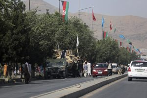 image of Kabul street with vehicles and flags