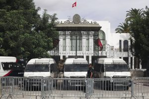 Police cars block the entrance of the Tunisian parliament