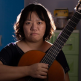 Pham Doan Trang holding a guitar