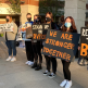 Masked students holding signs outside Central York High School